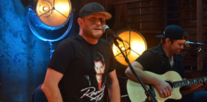 Cole Swindell performing
