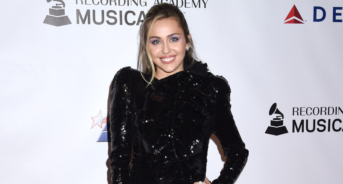 Miley Cyrus grabbed by fan in Barcelona with husband Liam Hemsworth