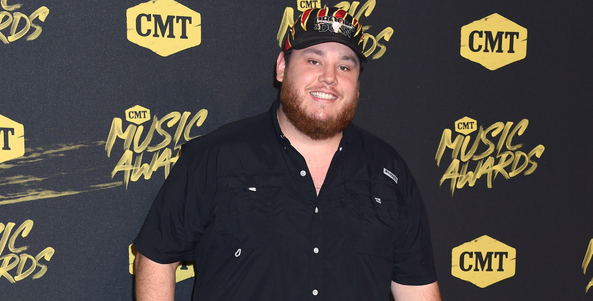 Luke Combs and Luke Combs songs in bio for One Country